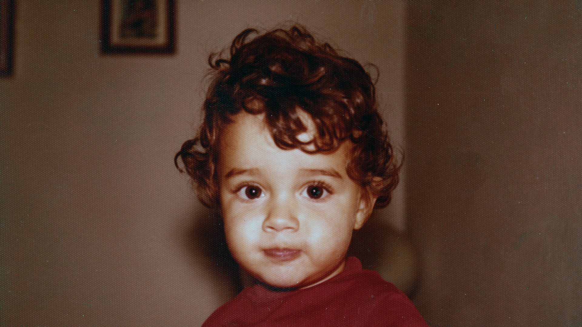 Image of Panos Kouvelis kid portrait front facing with red shirt Web.