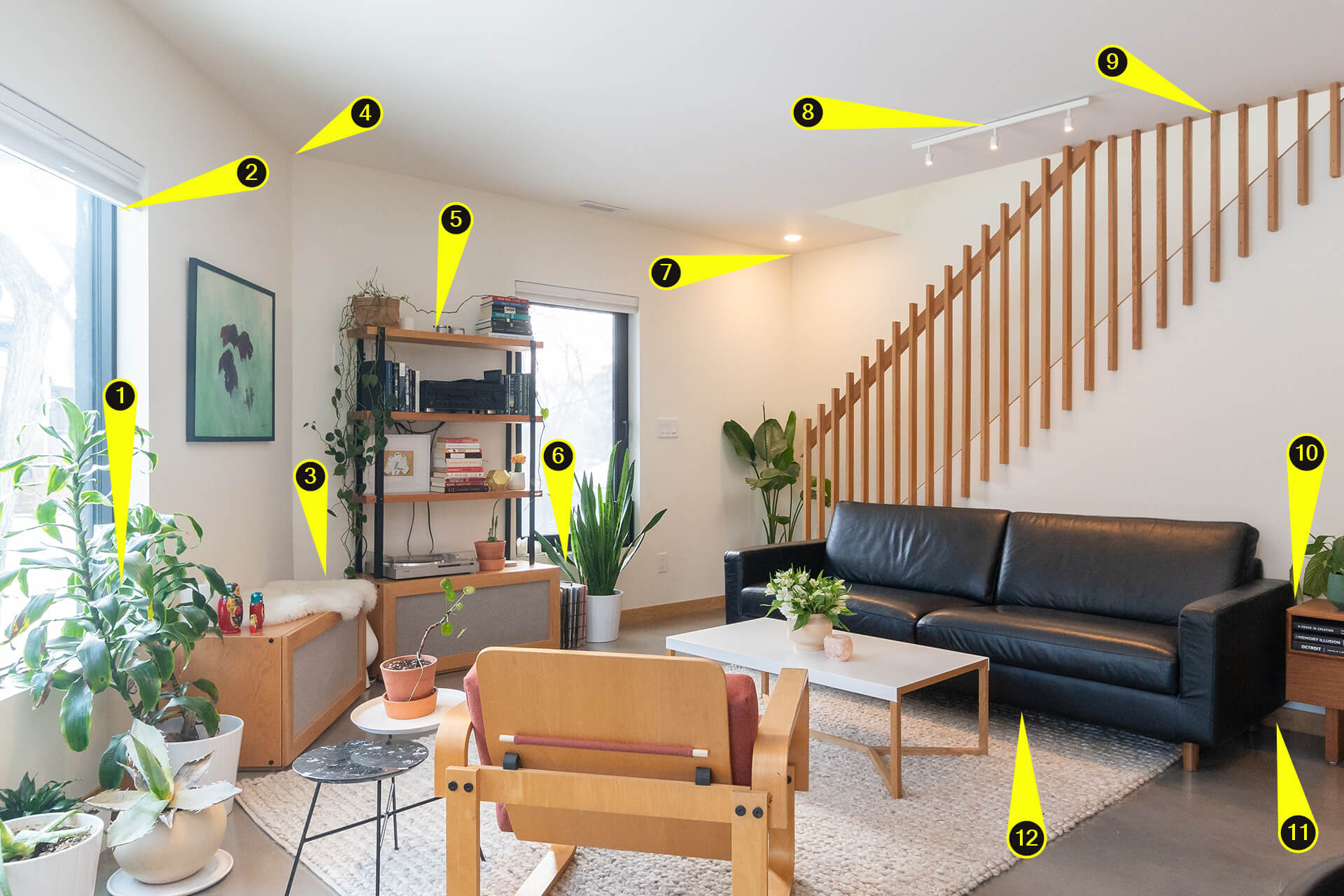 Image of Speaker placement examples on small modern living room next to stairs.
