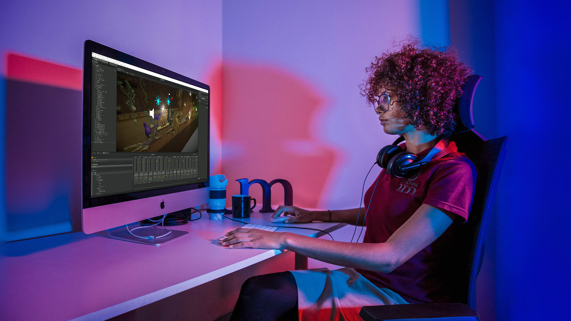 Image of Woman using silver iMac with Unity.